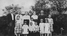 Fritzler Family and Friends Top row, left to right: 2nd from the far right, Carl Fritzler; far right, 6th person, Mollie Fritzler Bottom row, left to right: 1st person: Emma Fritzler; 2nd from the far right, Anna Fritzler.